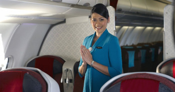 A flight attendant on a Garuda Indonesia flight