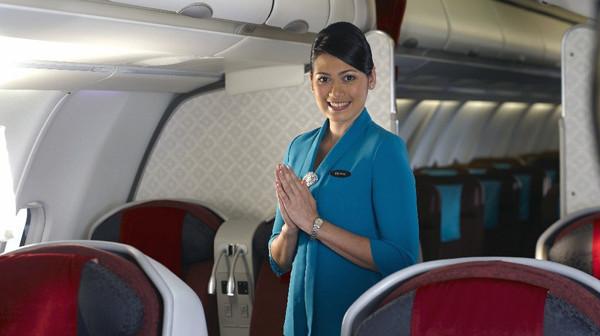 A flight attendant on a Garuda Indonesia flight