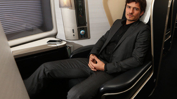 Orlando Bloom, seated in British Airways First, will be in Sydney for a special British Airways event in May