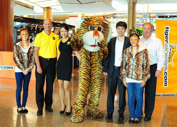 From left to right, are Campbell Wilson (CEO of Scoot), Koay Peng Yen (Tiger Airways' Group CEO) and Stewart Adams (Tiger Airways Singapore Managing Director).