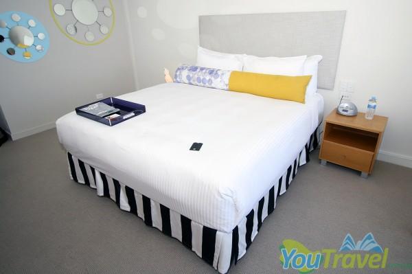 An iPod dock and kookaburra light adorn the huge king sized bed.