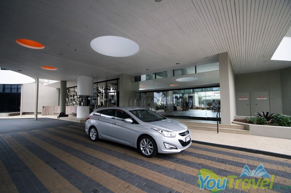 The large entrance forecourt of the QT Gold Coast Hotel leaves enough room to pass waiting guests.