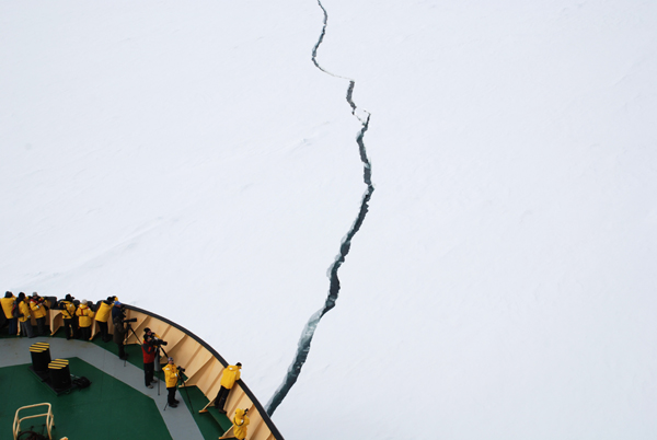 Cutting ice aboard Peregrine's icebreaker en route to the North Pole