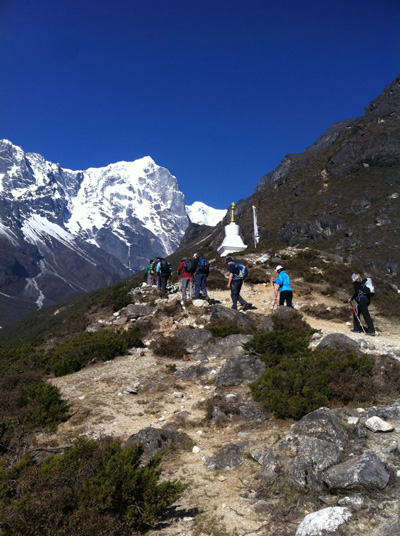 Nepal Trek - hiking past monument