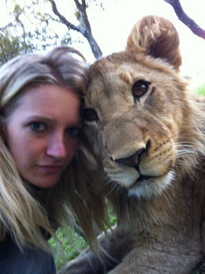 Kyne Van Den Berg with one of the rescued lions