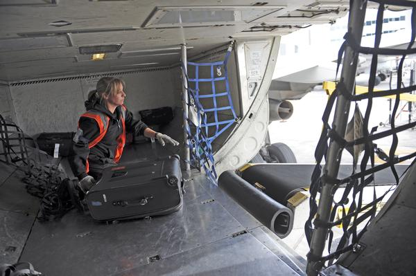 Baggage handlers really do rough up your luggage Photo credit: Denver Post