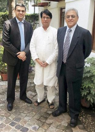 Union Minister of Civil Aviation, Ajit Singh (center) with Prasad Menon (right), Chairman nominee of the proposed joint venture between Tata Sons and Singapore Airlines, and Tata Sons' Director Mukund Rajan in New Delhi on Thursday
