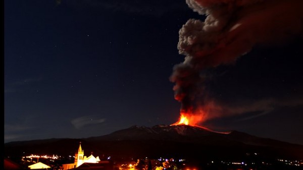 Mt. Etna, Europe's most active volcano, emits lava during an eruption as seen from Acireale, near the Sicilian town of Catania