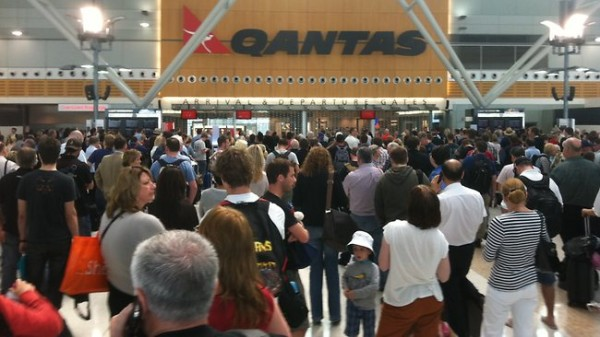 Passengers wait to be re-screened at Sydney airport