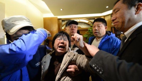 Angry relatives of missing passengers on Malaysia Airlines flight MH370 weep after hearing the news that the plane plunged into Indian Ocean at a hotel in Beijing on March 24, 2014.