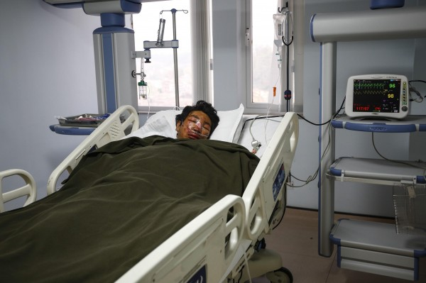 Nepalese Sherpa mountaineer Dawa Tashi, a survivor of the avalanche on Mount Everest, lies in a hospital intensive care unit in Katmandu