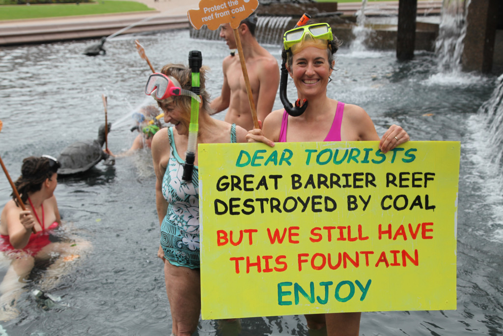 Sydneysiders snorkeling in Hyde Park fountain in protest of the expansion of coal ports on the Great Barrier Reef.